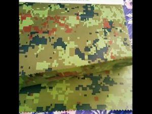 Fabricante de porcelana al por mayor de camuflaje en relieve rainwear geotextil tela para tela al aire libre